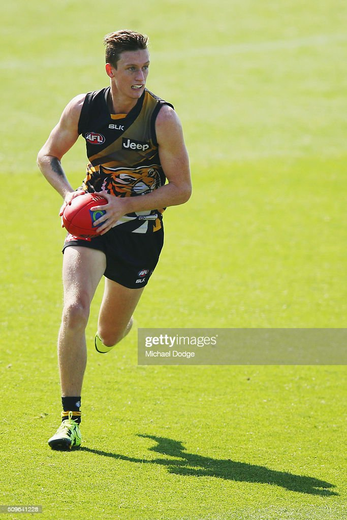 Connor Menadue of the Tigers runs with the ball during the Richmond Tigers AFL intra-club match at Punt Road Oval on February 12, 2016 in Melbourne, Australia.