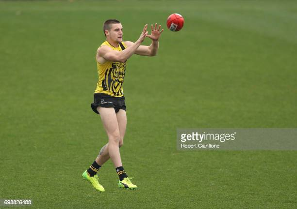 Connor Menadue of the Tigers takes the ball during a Richmond Tigers AFL training session at Punt Road Oval on June 21 2017 in Melbourne Australia