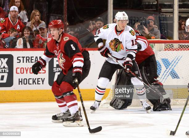 Connor Murphy of the Arizona Coyotes attempts to block a pass as Artem Anisimov of the Chicago Blackhawks looks to screen Coyotes goaltender Mike...