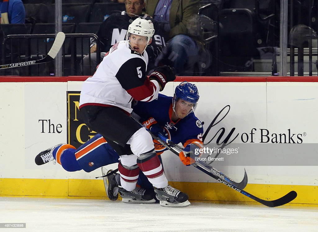 Connor Murphy of the Arizona Coyotes checks Brock Nelson of the New York Islanders during the first period at the Barclays Center on November 16 2015...