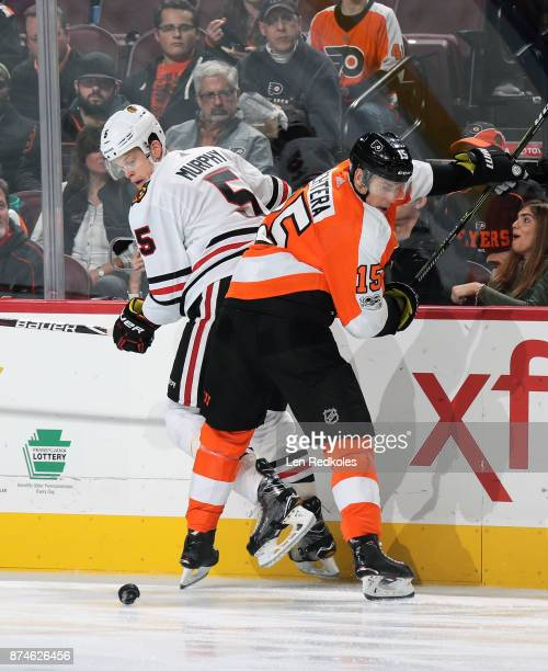 Connor Murphy of the Chicago Blackhawks battles for the puck along the boards against Jori Lehtera of the Philadelphia Flyers on November 9 2017 at...