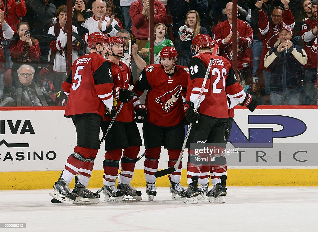 Connor Murphy #5, Shane Doan #19, Tobias Rieder #8 and Michael Stone #26 of the Arizona Coyotes celebrate a third period by teammate Antoine Vermette against the Buffalo Sabres at Gila River Arena on January 18, 2016 in Glendale, Arizona.