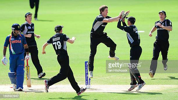 Connor Neynens of New Zealand celebrates the dismissal of Unmukt Chand of India during the ICC U19 Cricket World Cup 2012 Semi Final match between...