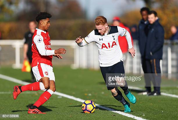 Connor Ogilvie of Tottenham Hotspur takes on Reiss Nelson of Arsenal during the Premier League 2 match between Tottenham Hotspur and Arsenal at...