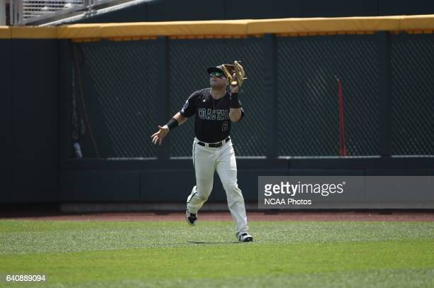 Connor Owings of Coastal Carolina University catches a fly ball for an out against the University of Arizona during Game 3 of the Division I Men's...
