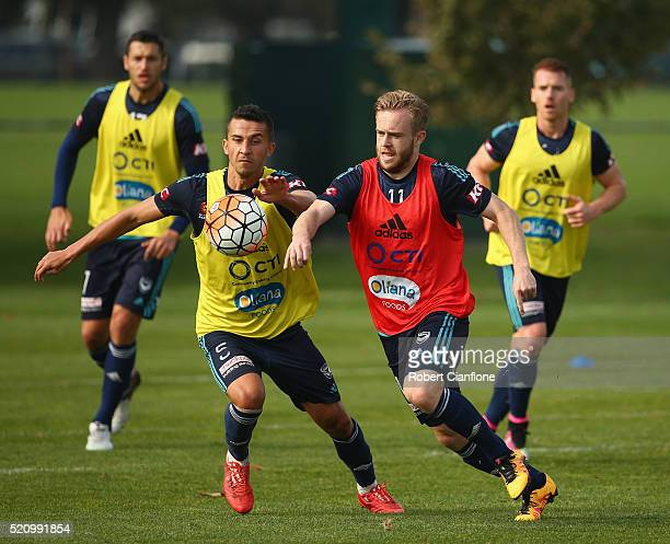 Connor pain is challenged by Daniel Georgievski during a Melbourne Victory ALeague training session at Gosch's Paddock on April 14 2016 in Melbourne...