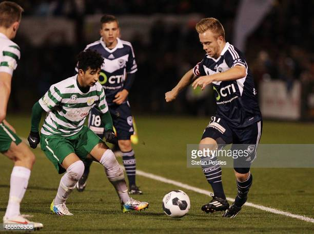 Connor Pain of Melbourne Victory and Muad Zwed of Tuggeranong United contest possession during the FFA Cup match between Tuggeranong United and...