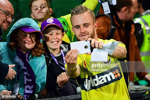 Connor Pain of the Central Coast Mariners celebrates the draw a selfie with the fans during the round one ALeague match between the Perth Glory and...