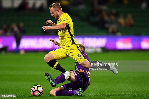 Connor Pain of the Central Coast Mariners is tackled by Rostyn Griffiths of the Perth Glory during the round one ALeague match between the Perth...