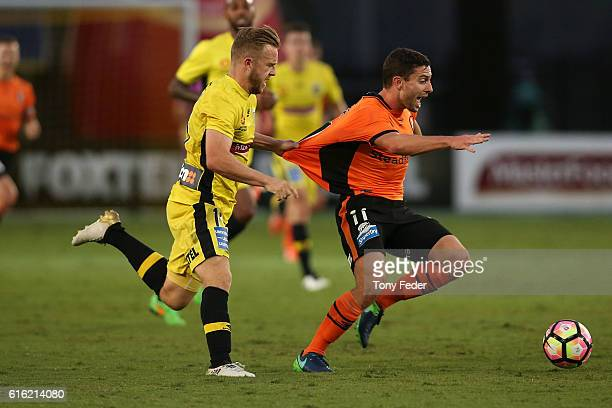 Connor Pain of the Mariners pulls the shirt of Thomas Oar of the Roar during the round three ALeague match between the Central Coast Mariners and the...