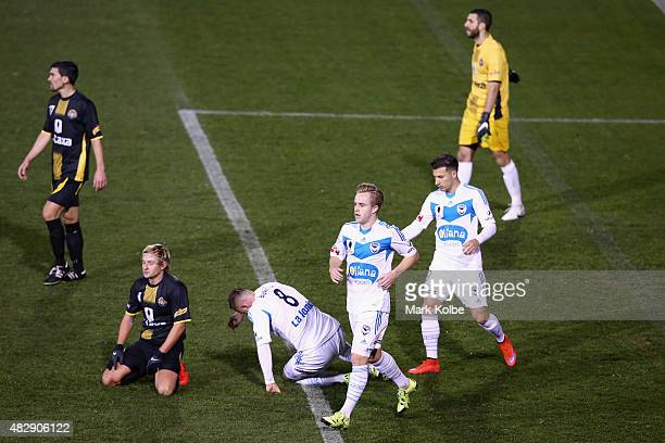 Connor Pain of the Melbourne Victory celebrates scoring a goal as the Tigers players look dejected during a FFA Cup match between Balmain Tigers FC...