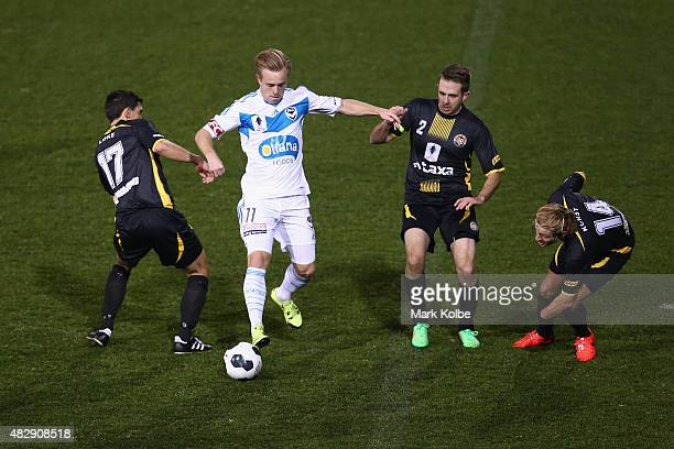 Connor Pain of the Melbourne Victory takes on Jehan Loke Thomas Hyde and Sergej Kunst of the Tigers during a FFA Cup match between Balmain Tigers FC...