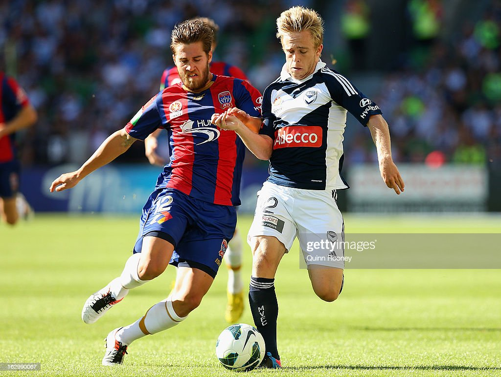 Connor Pain of the Victory and Joshua Brillante of the Jets contest for the ball during the round 23 A-League match between the Melbourne Victory and the Newcastle Jets at AAMI Park on March 3, 2013 in Melbourne, Australia.