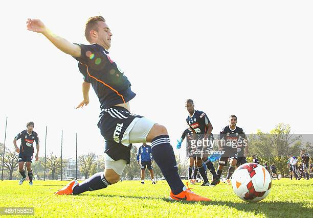 Connor Pain of the Victory competes for the ball during a Melbourne Victory ALeague training session at Gosch's Paddock on April 17 2014 in Melbourne...