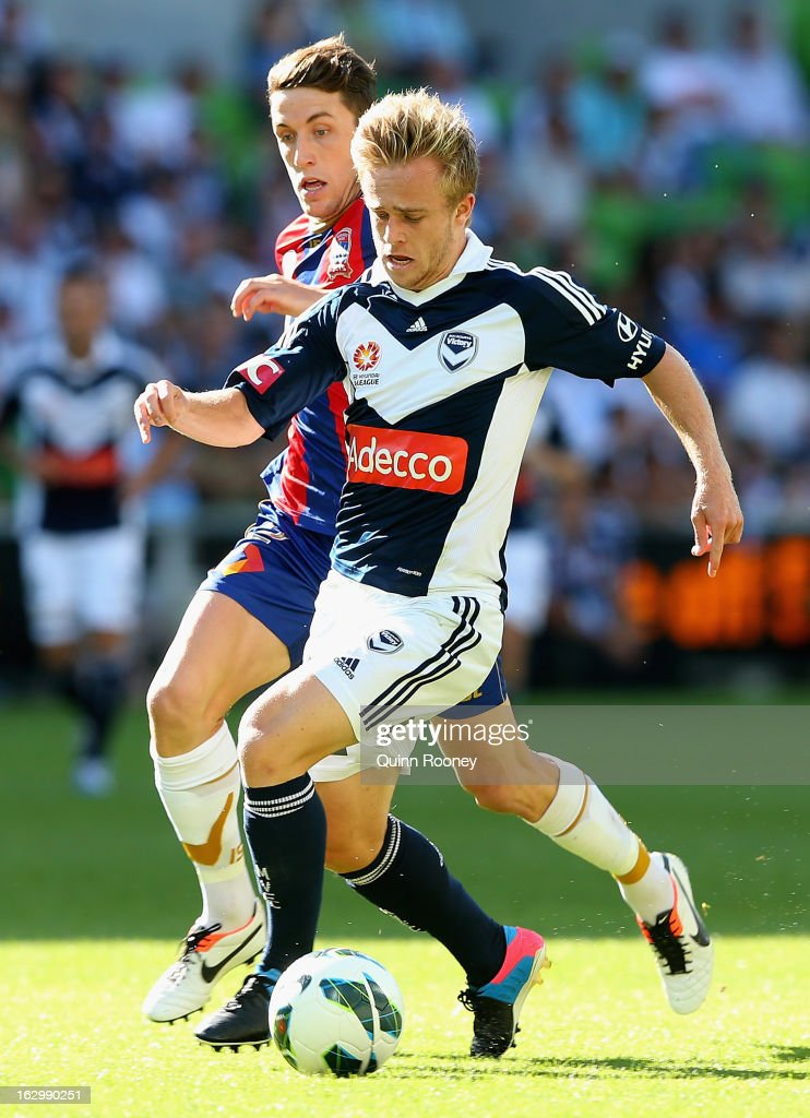 Connor Pain of the Victory looks to pass the ball during the round 23 A-League match between the Melbourne Victory and the Newcastle Jets at AAMI Park on March 3, 2013 in Melbourne, Australia.