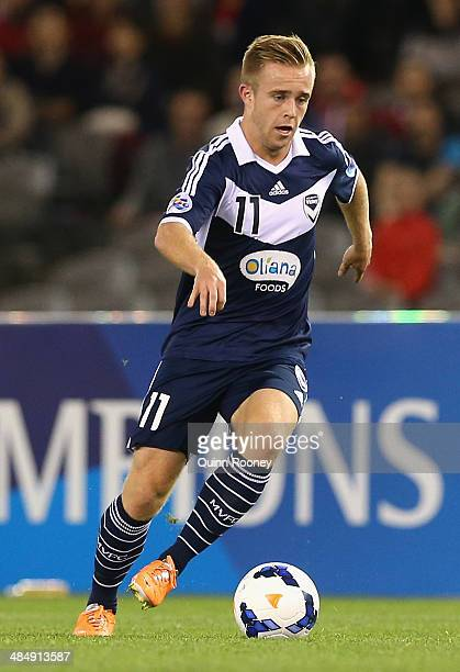 Connor Pain of the Victory passes the ball during the AFC Asian Champions League match between the Melbourne Victory and Guangzhou Evergrande at...