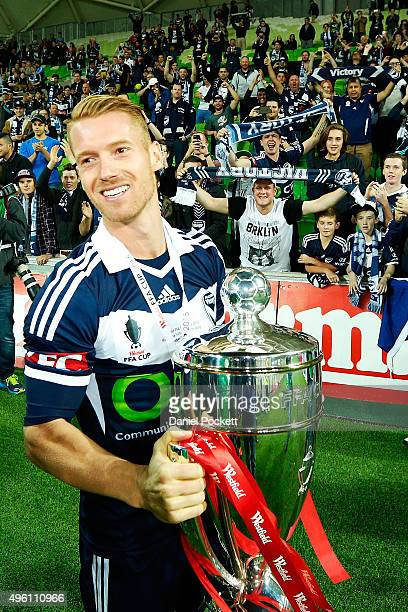 Connor Pain of the Victory poses with the FFA Cup after winning the FFA Cup Final match between Melbourne Victory and Perth Glory at AAMI Park on...