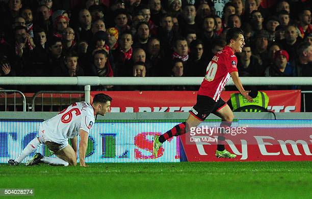 Connor Randall of Liverpool looks dejected as Tom Nichols of Exeter City celebrates scoring their opening goal during the Emirates FA Cup third round...