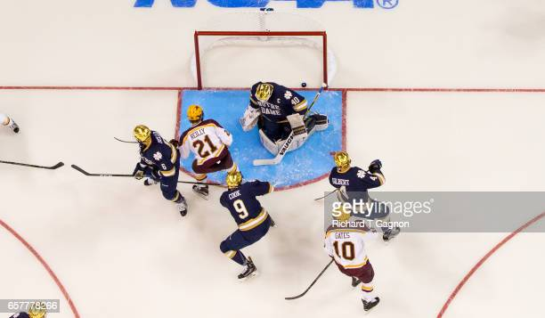 Connor Reilly of the Minnesota Golden Gophers scores against Cal Petersen of the Notre Dame Fighting Irish during game two of the NCAA Division I...