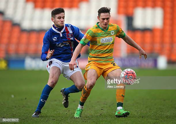 Connor Roberts of Yeovil Town holds off a challenge from Macaulay Gillesphey of Carlisle United during The Emirates FA Cup Third Round match between...
