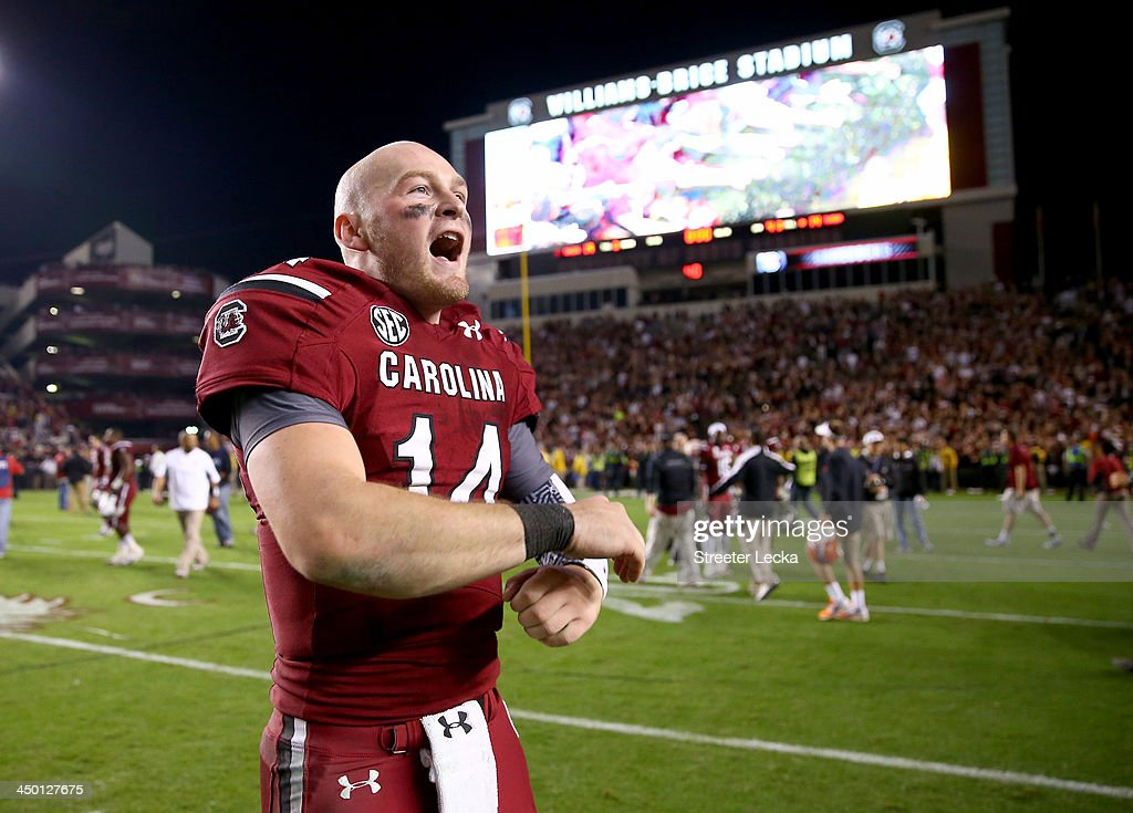 Connor Shaw #14 of the South Carolina Gamecocks celebrates after defeating the Florida Gators 19-14 during their game at Williams-Brice Stadium on November 16, 2013 in Columbia, South Carolina.