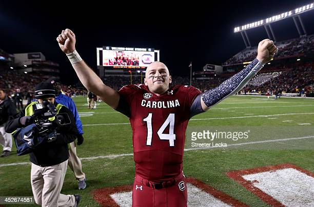 Connor Shaw of the South Carolina Gamecocks celebrates after defeating the Clemson Tigers 3117 at WilliamsBrice Stadium on November 30 2013 in...