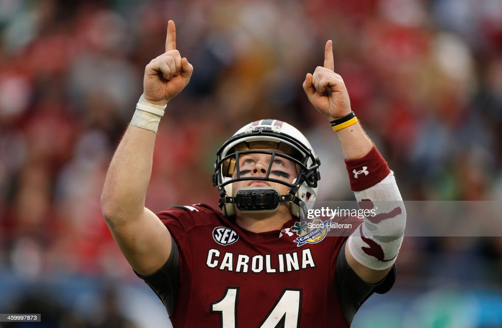 Connor Shaw of the South Carolina Gamecocks celebrates after throwing a touchdown pass during the second half of their game against the Wisconsin...