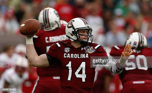 Connor Shaw of the South Carolina Gamecocks looks turnover pass during the first half of their game against the Wisconsin Badgers at the Capital One...