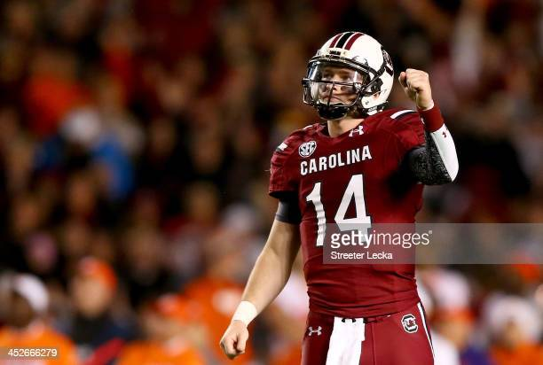 Connor Shaw of the South Carolina Gamecocks reacts after his team scores a touchdown during their game against the Clemson Tigers at WilliamsBrice...