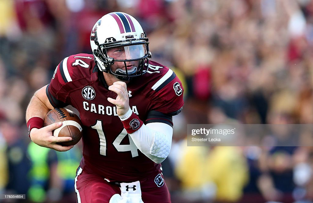 Connor Shaw #14 of the South Carolina Gamecocks runs with the ball against the North Carolina Tar Heels during their game at Williams-Brice Stadium on August 29, 2013 in Columbia, South Carolina.