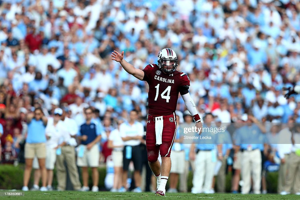 Connor Shaw #14 of the South Carolina Gamecocks signals a first down against the North Carolina Tar Heels during their game at Williams-Brice Stadium on August 29, 2013 in Columbia, South Carolina.