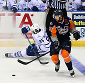 Connor Sills of the Flint Firebirds misses a check from Daniel MuzitoBagenda of the Mississauga Steelheads during OHL game action on October 4 2015...