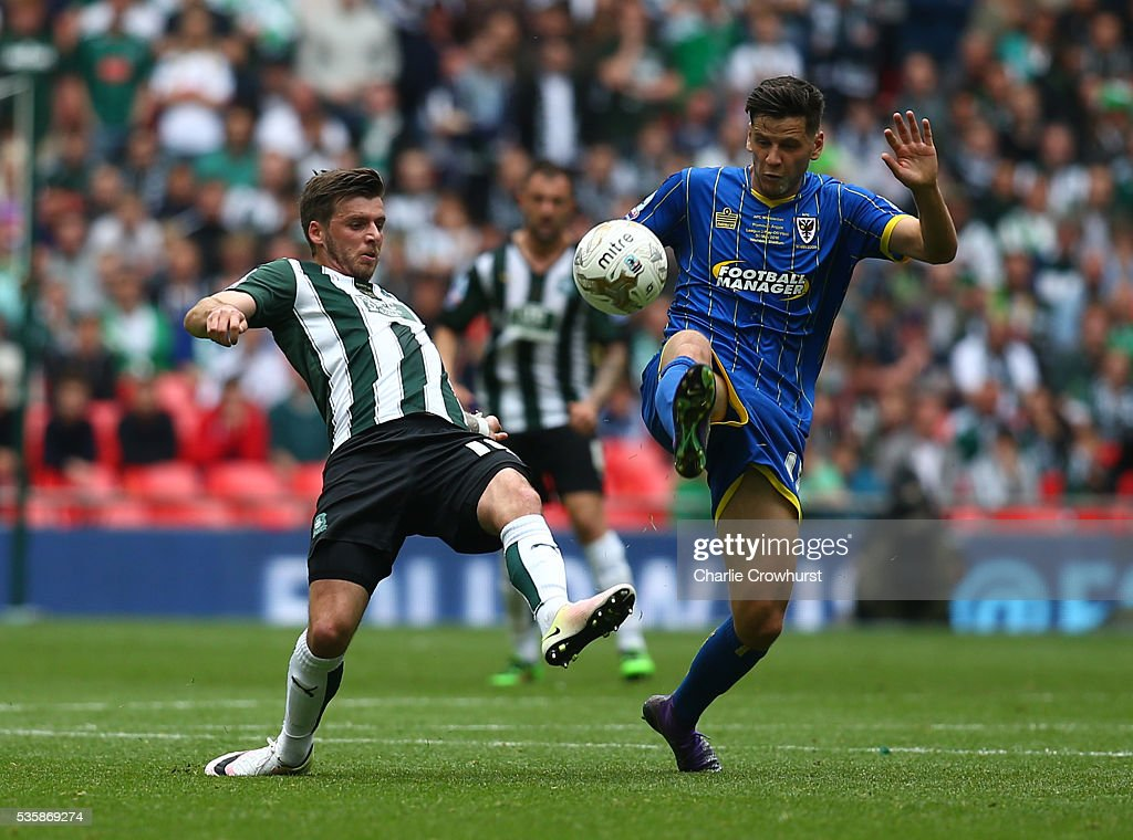 Connor Smith (R) of AFC Wimbledon beats Graham Carey of Plymouth to the ball during the Sky Bet League 2 Play Off Final between Plymouth Argyle and AFC Wimbledon at Wembley Stadium on May 30, 2016 in London, England.