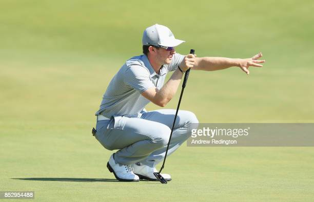 Connor Syme of Scotland lines up a putt on the 18th green during day four of the Portugal Masters at Dom Pedro Victoria Golf Club on September 24...