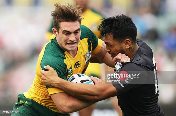 Connor Watson of the Junior Kangaroos is tackled during the International Rugby League match between the Junior Kangaroos and the Junior Kiwis at...
