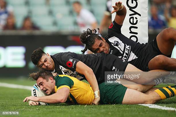 Connor Watson of the Junior Kangaroos scores a try during the International Rugby League match between the Junior Kangaroos and the Junior Kiwis at...