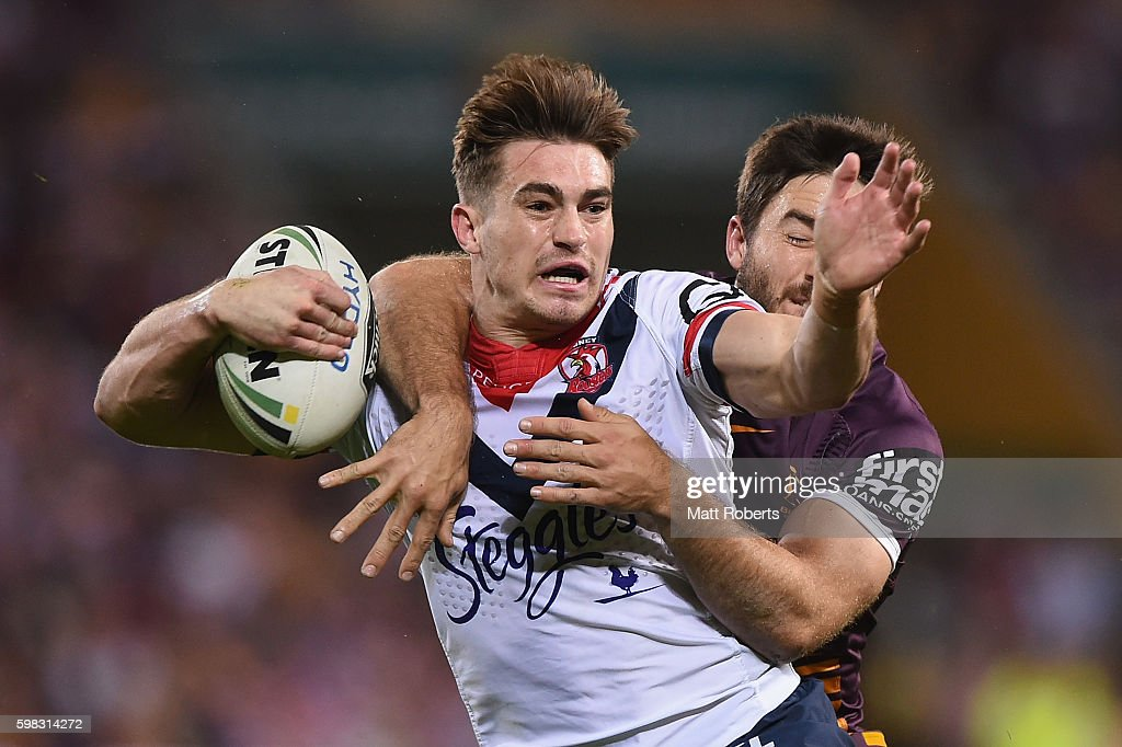 Connor Watson of the Roosters is tackled by Ben Hunt of the Broncos during the round 26 NRL match between the Brisbane Broncos and the Sydney Roosters at Suncorp Stadium on September 1, 2016 in Brisbane, Australia.