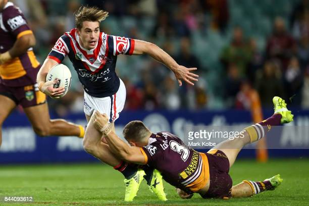 Connor Watson of the Roosters is tackled by James Roberts of the Broncos during the NRL Qualifying Final match between the Sydney Roosters and the...