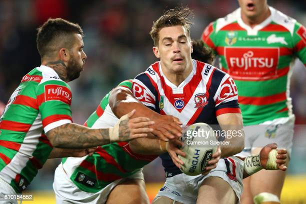 Connor Watson of the Roosters is tackled during the round 18 NRL match between the Sydney Roosters and the South Sydney Rabbitohs at Allianz Stadium...