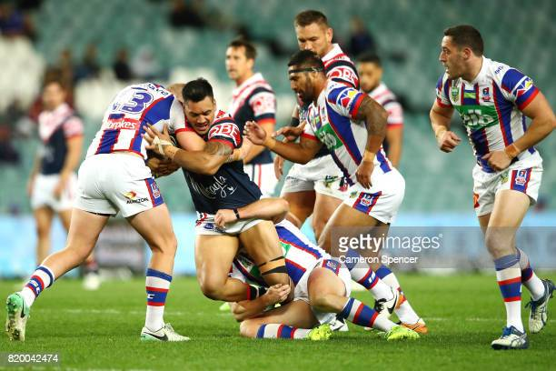 Connor Watson of the Roosters is tackled during the round 20 NRL match between the Sydney Roosters and the Newcastle Knights at Allianz Stadium on...