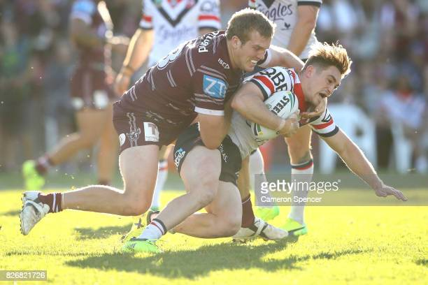 Connor Watson of the Roosters is tackled during the round 22 NRL match between the Manly Warringah Sea Eagles and the Sydney Roosters at Lottoland on...