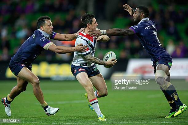 Connor Watson of the Roosters passes the ball during the round 20 NRL match between the Melbourne Storm and the Sydney Roosters at AAMI Park on July...