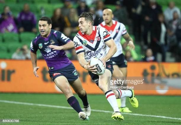 Connor Watson of the Roosters runs with the ball during the round 23 NRL match between the Melbourne Storm and the Sydney Roosters at AAMI Park on...