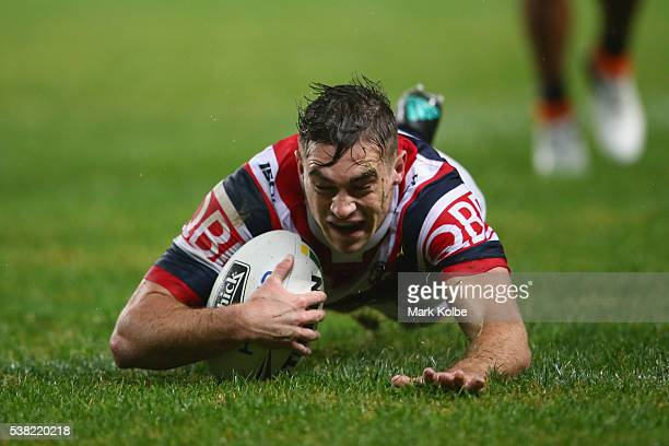 Connor Watson of the Roosters scores a try during the round 13 NRL match between the Sydney Roosters and the Wests Tigers at Allianz Stadium on June...