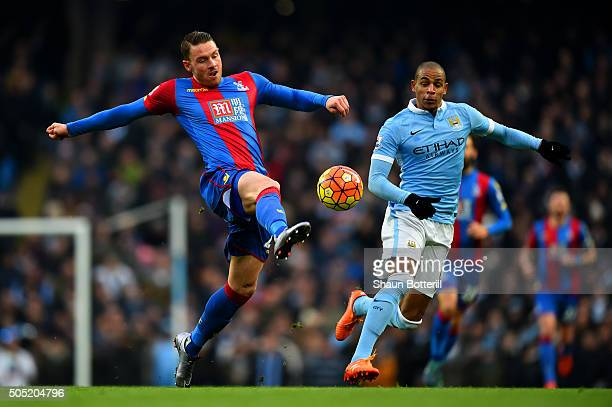 Connor Wickham of Crystal Palace attempts to control the ball under pressure from Fernando of Manchester City during the Barclays Premier League...