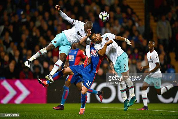 Connor Wickham of Crystal Palace battles with Angelo Ogbonna and Winston Reid of West Ham United during the Premier League match between Crystal...