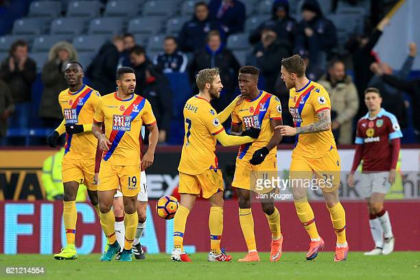 Connor Wickham of Crystal Palace celebrates scoring his sides first goal with his Crystal Palace team mates during the Premier League match between...