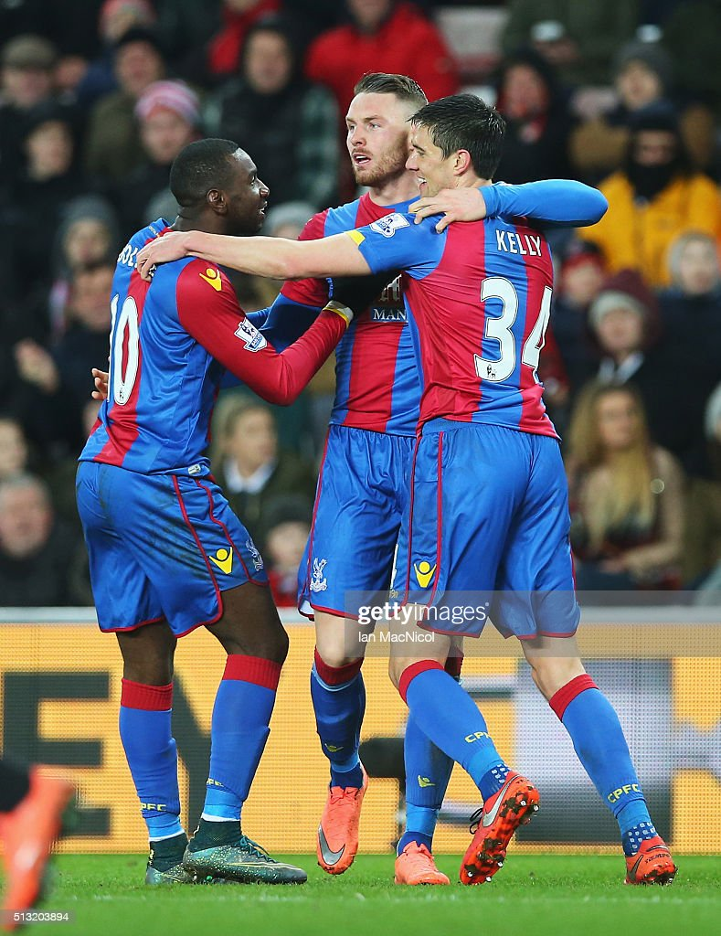 Connor Wickham (C) of Crystal Palace celebrates scoring his team's first goal with his team mates Yannick Bolasie (L) and Martin Kelly (R) during the Barclays Premier League match between Sunderland and Crystal Palace at Stadium of Light on March 1, 2016 in Sunderland, England.