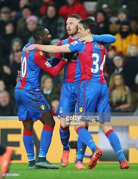 Connor Wickham of Crystal Palace celebrates scoring his team's first goal with his team mates Yannick Bolasie and Martin Kelly during the Barclays...