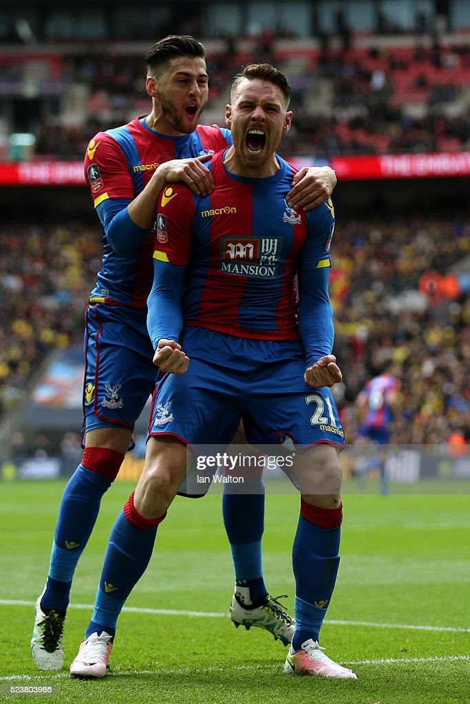 Connor Wickham of Crystal Palace (21) celebrates with Joel Ward as he scores their second goal with a header during The Emirates FA Cup semi final match between Watford and Crystal Palace at Wembley Stadium on April 24, 2016 in London, England.